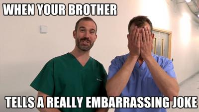 Two doctors, one holding his hands up to his face