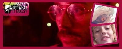 A man covered in a red filter (Portugal. The Man) next to two framed pictures of kids singing.