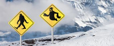 A mountain with a yeti and a ghost warning sign.
