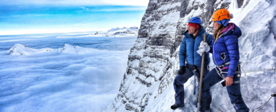 Steve Backshall and fellow Eiger climber is at the viewing area half way up the mountain, they look out at the view.