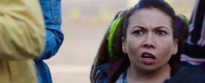 A young girl in a crowd looking confused, Sasha from The Dumping Ground.