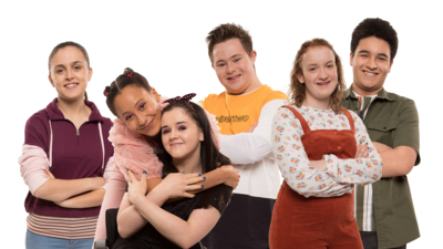 Six young people smiling and standing in a group, Jody, Candi-Rose, Chloe, Finn, Floss and Bird from The Dumping Ground Series 8.