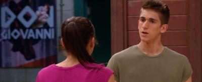 A boy in a dance studio, talking to a gril whilst looking confused, Noah and Jacquie from the Next Step.