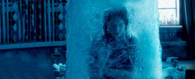 A girl in school uniform is trapped in a huge block of ice and frozen, Mildred Hubble.