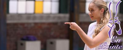 A girl in a dance studio pointing. Richelle from The Next Step.