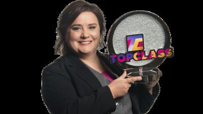 Susan Calman holding the Top Class trophy.