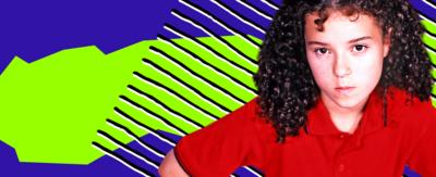 Tracy stares defiantly, behind her is a bright purple and green '90s themed background.