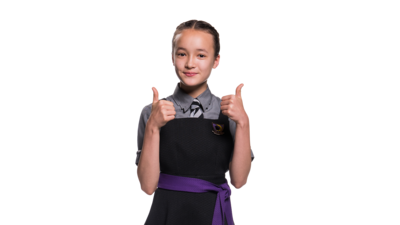 Girl in school uniform with two thumbs up. Felicity from the Worst Witch.