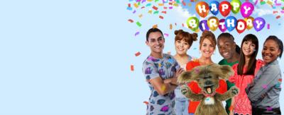CBeebies Birthday Card Celebration Image with Happy Birthday written on Balloons in the background with the CBeebies House presenters in front with Ben, Evie, Katie, Dodge, Nigel, Rebecca and Joanna
