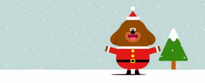 Duggee is in a Father Christmas outfit on a snowy background.