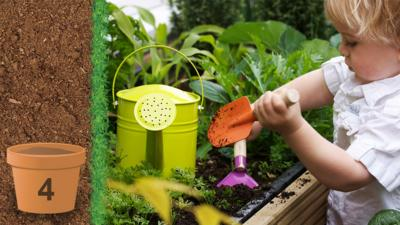 A little boy using colourful hgardening tools to do some gardening