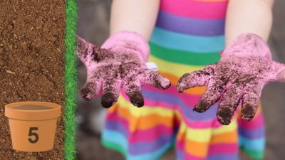 A childs hands wearing gardening gloves that are covered in soil