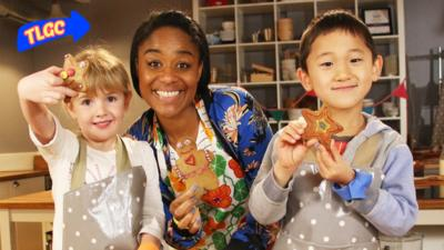 Joanna and two children holding with gingerbread shapes