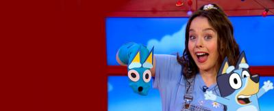 Evie with a Bluey sock puppet on her right hand and an image of Bluey to her right.