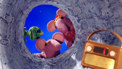 Tiny and Small Clanger and Baby Soup Dragon from The Clangers staring into a crater at a strange box.