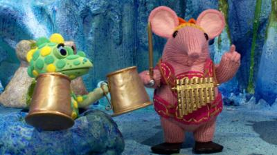 Tiny Clanger from The Clangers with her panpipes and the Soup Dragon holding tankards.