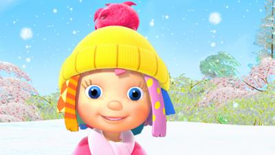 Rosie from Everything's Rosie in a woolly hat in the snow.