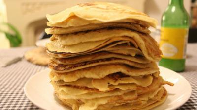 A stack of pancakes on a table.