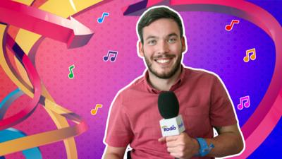 Martin from The Let's Go Radio Club holding a CBeebies Radio microphone