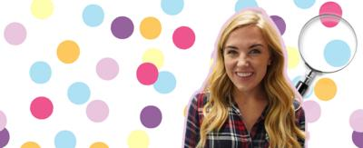 Maddie is smiling to camera, a magnify glass is behind her over a multi coloured polka dot background.