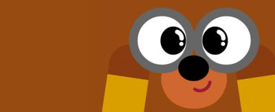 Close up of Hey Duggee looking through binoculars.