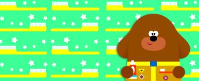 Hey Duggee holding a tooth brush, green background with toothbrushes and stars.