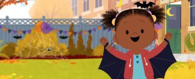 JoJo wearing a bat wing halloween costume.