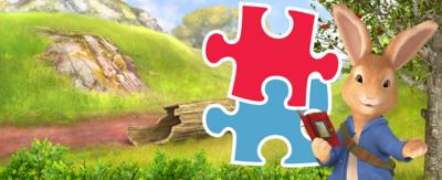 Peter Rabbit with blue and red jigsaw pieces.