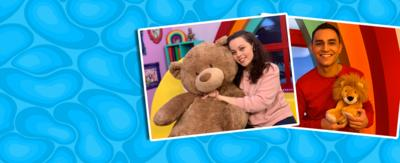 Evie and Ben from CBeebies house hugging teddy bears.