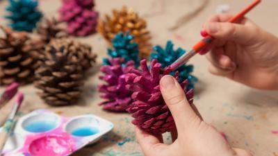 Painting pinecones.