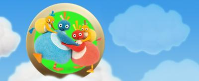 Twirlywoos on a sky blue background with clouds.