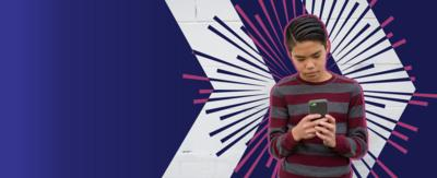 Young teen looking at his phone distressed