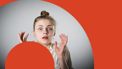 A young girl looks panicked with red circles around her