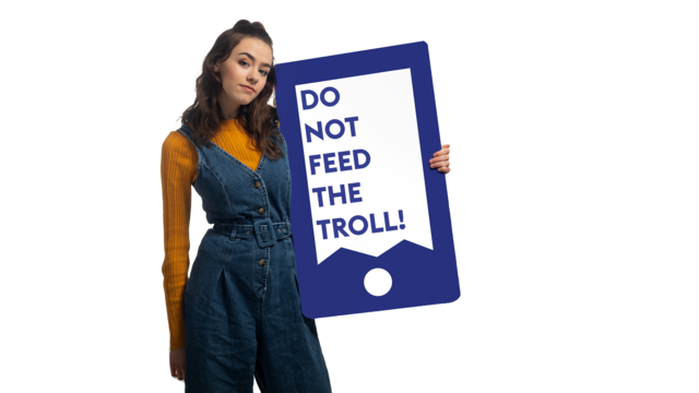 "Amelia Mandeville holding a phone that states ""do not feed the troll!"""