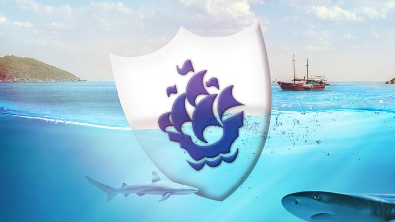 A giant Blue Peter badge in the sea with sharks and a ship.