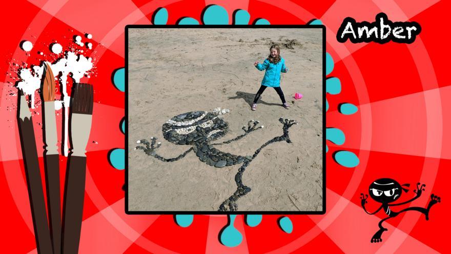 ed25f221678d An Art Ninja character made in pebbles on a beach.