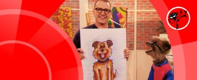 A man holds up a portrait of a dog, while a dog puppet looks on.