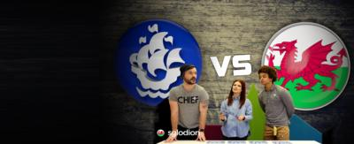 Blue Peter logo VS Welsh flag. Barney, Lindsey and Radzi standing over a table, smiling.