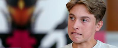 A boy looking unhappy.