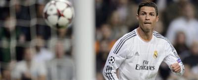 Cristiano Ronaldo looking at a ball thats heading towards the net