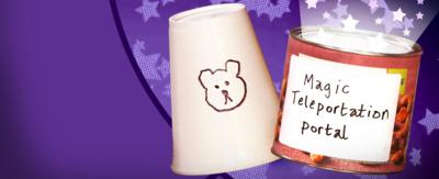 A cup with a teddy bear's face drawn on and a tin with the words 'Magic Teleportation Device' scribbled on in front of a purple, starry background.