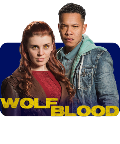 A girl with long red hair stands next to a tall boy in a demin jacket behind the Wolfblood logo (Jana and TJ).