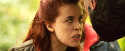 A Wolfblood (Jana) baring her teeth.