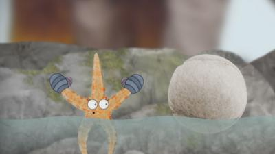 Sally the starfish from Old Jack's Boat: Rockpool Tales next to a tennis ball floating in a rockpool.