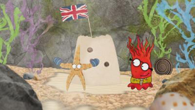 Sally the starfish and Andrew the anemone from Old Jack's Boat: Rockpool Tales in front of a sandcastle with a flag on it.