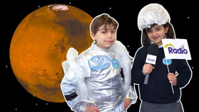 Two CBeebies Radio Rocket Reporters from CBeebies Stargazing wearing space costumes in front of the planet Mars.