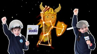 Two CBeebies Radio Rocket Reporters from CBeebies Stargazing wearing space costumes in front of the constellation of Orion.