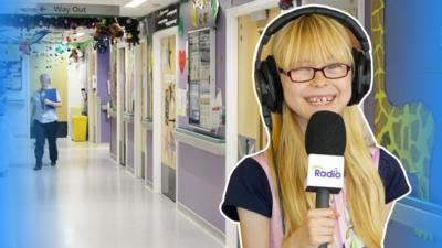 Angharad from CBeebies Hospital Heroes in a hospital corridor.