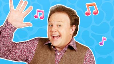 Justin Fletcher from Justin's Saturday Show waving.