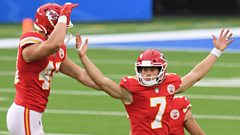 Harrison Butker celebrates his game-winning field goal against the Los Angeles Chargers
